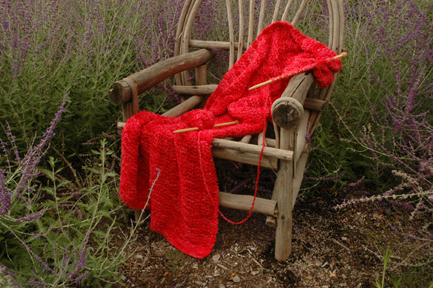 Red shawl on chair