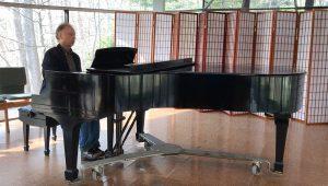 Rev. Ed Thompson at piano